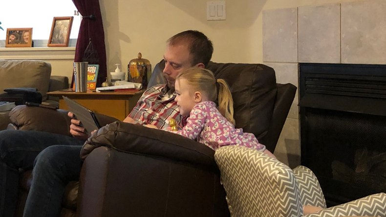 Father and Child playing iPad PBS Games